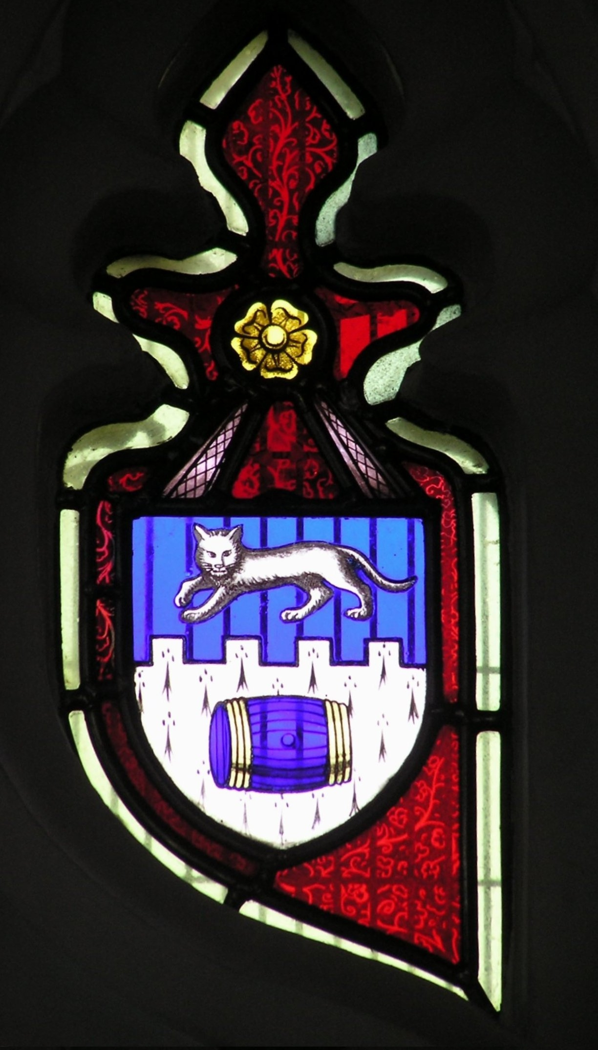 Stained glass rebus in south window of Church - 1850