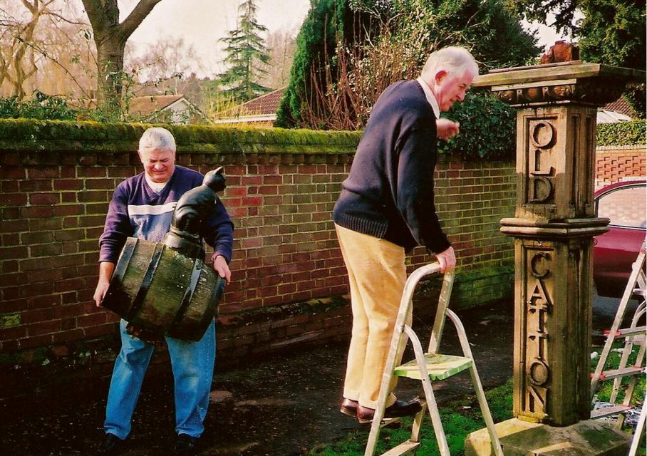 Parish Chairman David Thompson on steps - Melvyn Johnson removes barrel