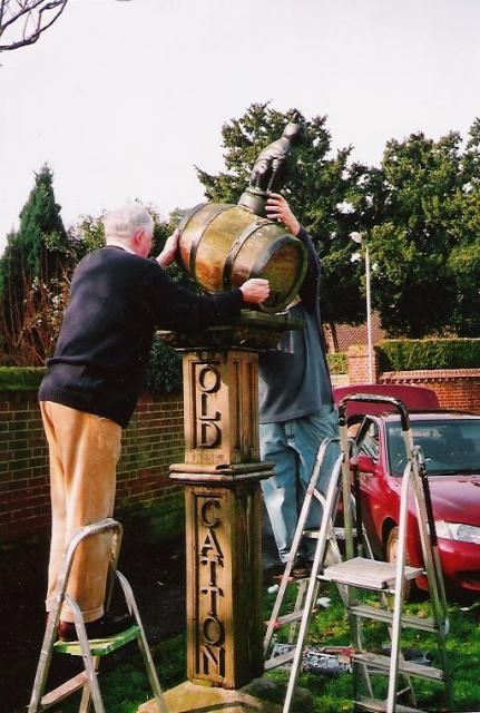 David Thompson, Parish chairman removes barrel from wooden post for the last time