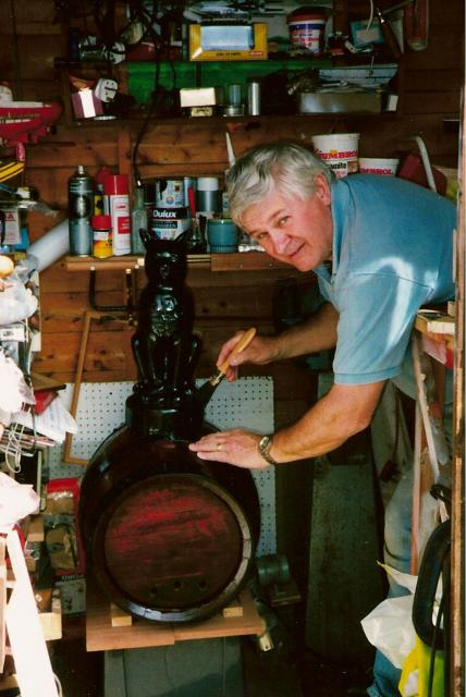 Melvyn Johnson repaints the cat and barrel in his workshhop